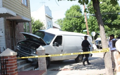 Woman Seriously Injured After Van Jumps Curb