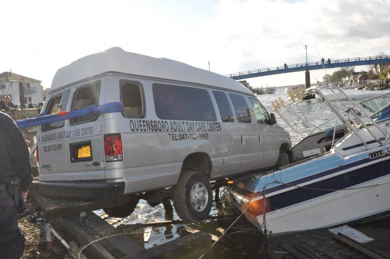 Van Crashes Onto Boat in Hawtree Basin