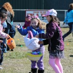 Eggcited egg hunters compare their haul and wait anxiously to trade eggs for toys and prizes.