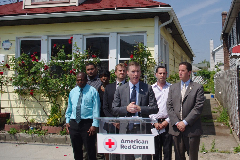 Rockaway homeowner Felix Lyons, left; Friends of Rockaway Apprentice Joseph Lopez; Lynette Shelborne-Barfield, constituent liaison for state Sen. James Sanders, Jr; Friends of Rockaway Director Todd Miner; American Red Cross Greater New York Region CEO Josh Lockwood; Friends of Rockaway Founder Michael Sinensky; and state Assemblyman Phil Goldfeder gather to announce the American Red Cross awarded a $721,550 grant to Friends of Rockaway this week. Photo Courtesy of the American Red Cross