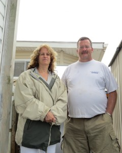 Sophia Vailakis-DeVirgilio and Mike McLoughlin stand in the spot where McLoughlin was attacked by two men stealing copper pipes from Vailakis-DeVirgilio's Broad Channel home earlier this month. Anna Gustafson/The Forum Newsgroup