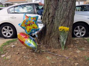 Friends and family set up a memorial for Danthony McDonald, including balloons that had been meant for what would have been McDonald's 20th birthday. Robert Stridiron/The Forum Newsgroup