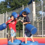 In the jousting pit, battling brothers, Bryton and Jasper Gomez, 9 and 12, fought it out as onlookers rooted them on.