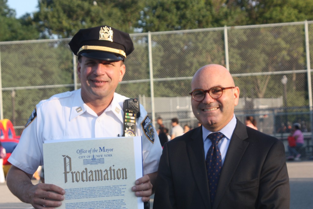 Captain Manson is all smiles after being presented with a proclamation from Mayor Bloomberg.