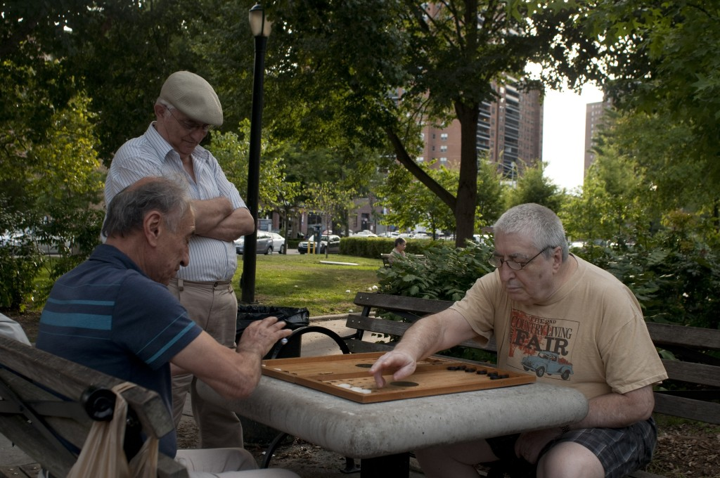 GregoriyIvyayev, Eddie Usupokov and Vladimir Vopian play backgammon in MacDonald Park in Forest Hills, Queens. Forest Hills, like many neighborhoods throughout Queens, have a large aging immigrant population that has a set of needs that will need to be met as they continue to get older Kate Bubacz/The Forum Newsgroup
