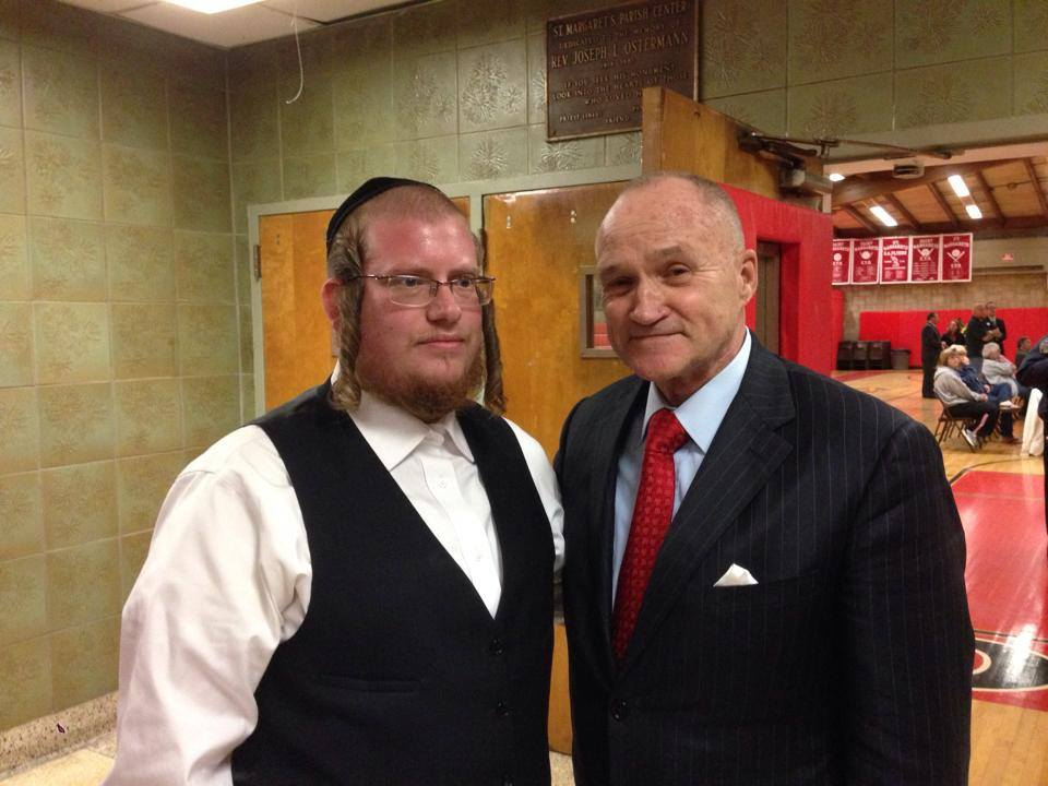 104th Precinct Community Council Vice President Abraham Markowitz, left, meets with NYPD Commissioner Ray Kelly at the council's latest meeting. Photos Courtesy 104th Precinct Community Council