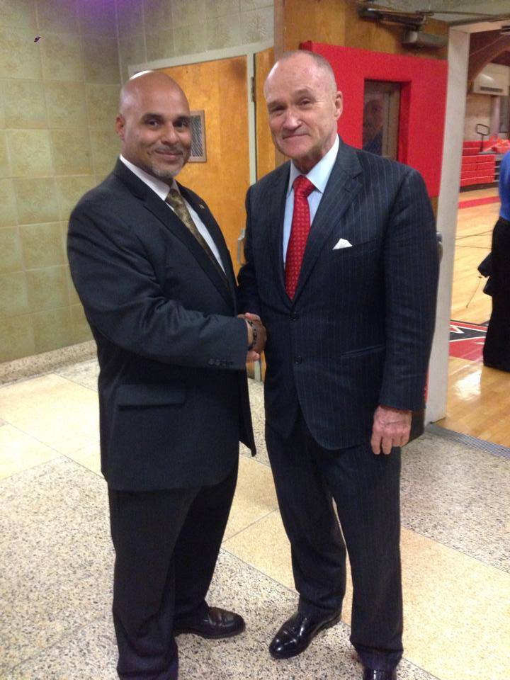 104th Precinct Community Council President Mario Matos, Jr. and NYPD Commissioner Ray Kelly spend time at the council meeting. Kelly welcomed new members of the council's board during the event.