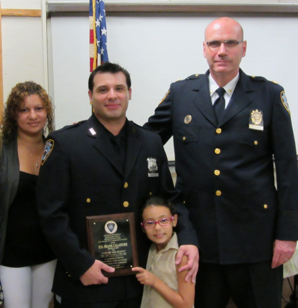 Officer Frank Calafiore surrounded by his proud wife and daughter and commanding officer Deputy Inspector Thomas Pascale. Photo Courtesy of Lindenwood Alliance