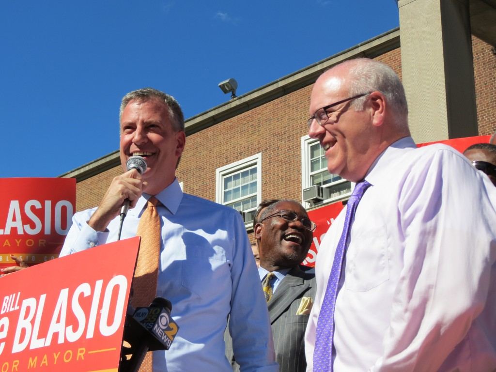 Public Advocate Bill de Blasio, left, landed an endorsement for the Democratic candidate's bid for mayor from U.S. Rep. Joseph Crowley and the Queens County Democrats on Monday.