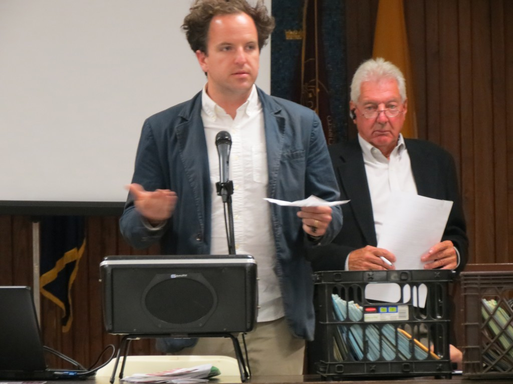 Tyler Myers, manager at the Knockdown Center in Maspeth, asked Community Board 5 at its meeting last Wednesday to support the center's request for a liquor license. Anna Gustafson/The Forum Newsgroup