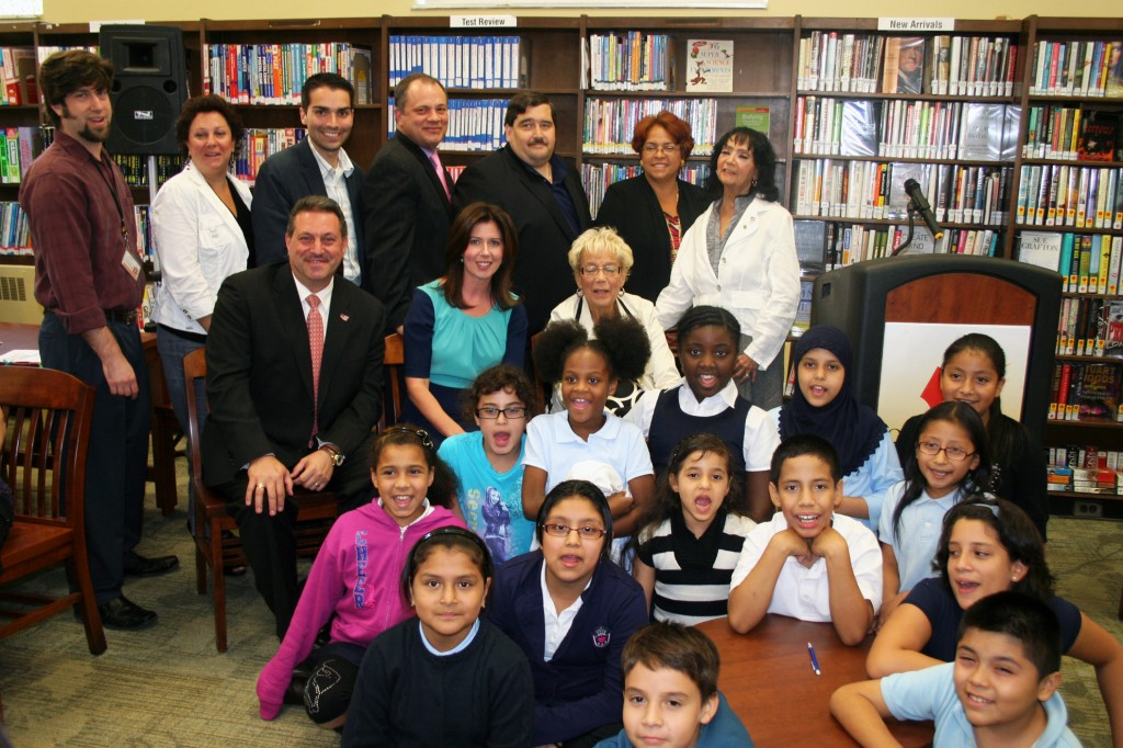 Legislators, library officials, civic leaders and area students celebrate the re-opening of the Queens Library at Woodhaven on Tuesday. Photo Courtesy of Queens Library