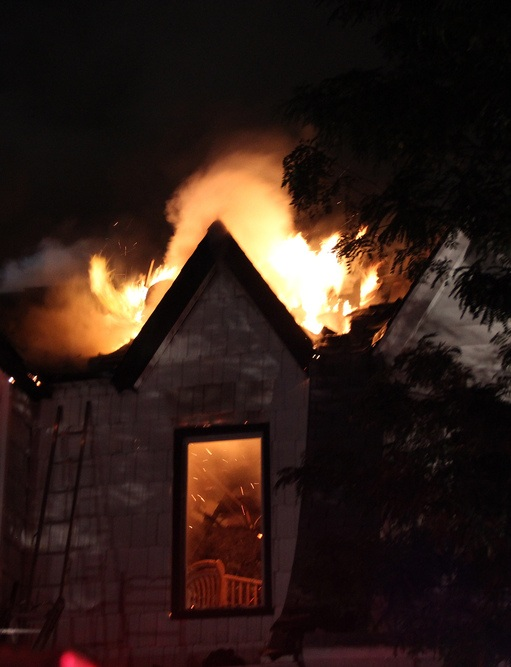 A baby's crib is seen clearly after firefighters broke out a front window in the second story revealing inferno like conditions. Richard York/The Forum Newsgroup