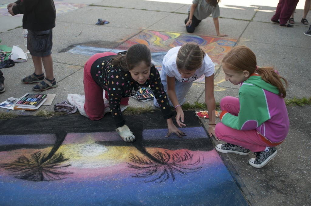 Fay Shemper, 11;  Abigail Glezer, 10; and Ilana, 9, work on Fay's chalk drawing of a beach scene. Kate Bubacz/The Forum Newsgroup