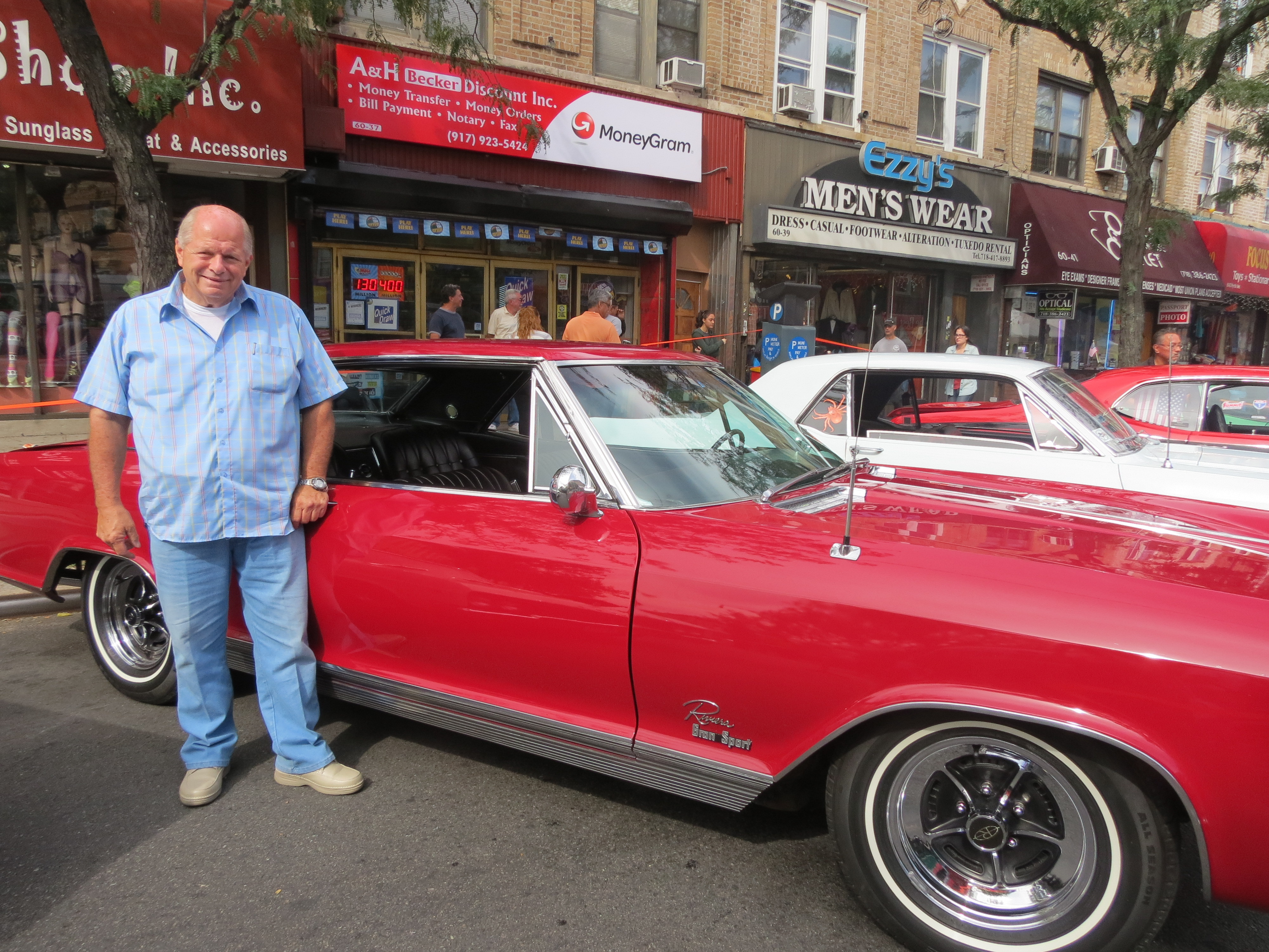 "Kenny Vasti, of Patchogue, L.I., shows off his 1965 Buick Riviera at the festival, where numerous classic car owners exhibited models from decades ago. ""I used to work for Buick in '65, and I loved this car then, but I couldn't afford it. I waited 45 years to get this,"" smiled Vasti, who bought the car four years ago."