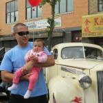 Glendale residents Dorin Djura and his daughter, Lucciana, Djura, 7 months, were thrilled by the sea of classic cars that were brought to the event through the East Coast Car and Riviera Owners Association.