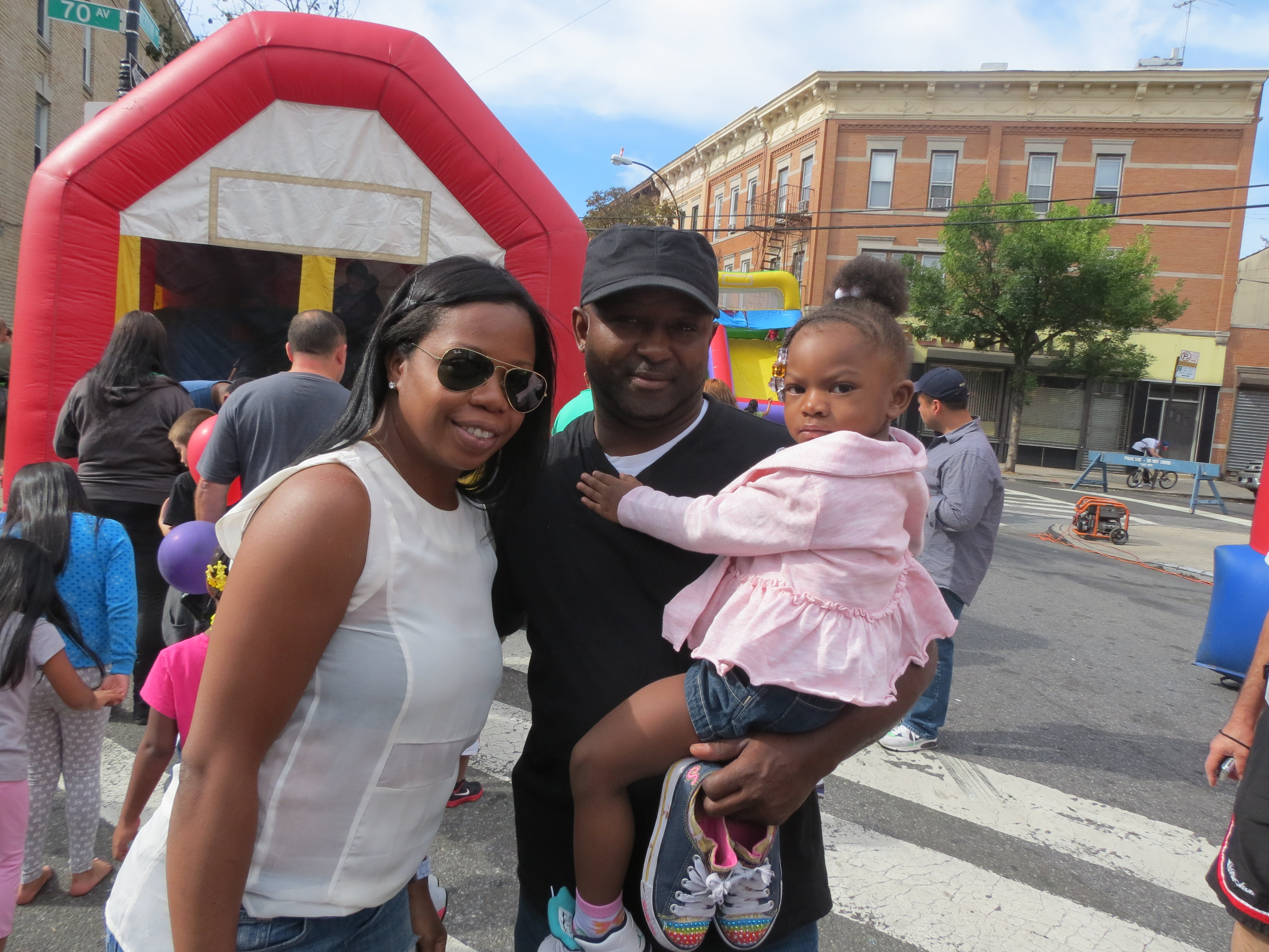 Glenda, left, 2-year-old London, and Anthony Shaw, of Ridgewood, enjoy the afternoon at the festival.