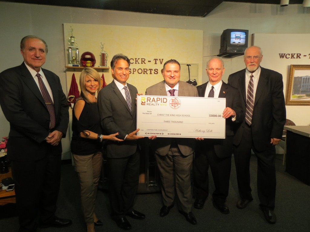 Christ the King Principal Peter Mannarino, left, Lauren Cipolla, Frank Cipolla, Anthony Lolli, former state Sen. Serf Maltese, and former City Councilman Tom Ognibene attend a ceremony Friday, during which Lolli presented the Middle Village school with a $3,000 check for its broadcast journalism scholarship. Anna Gustafon/The Forum Newsgroup