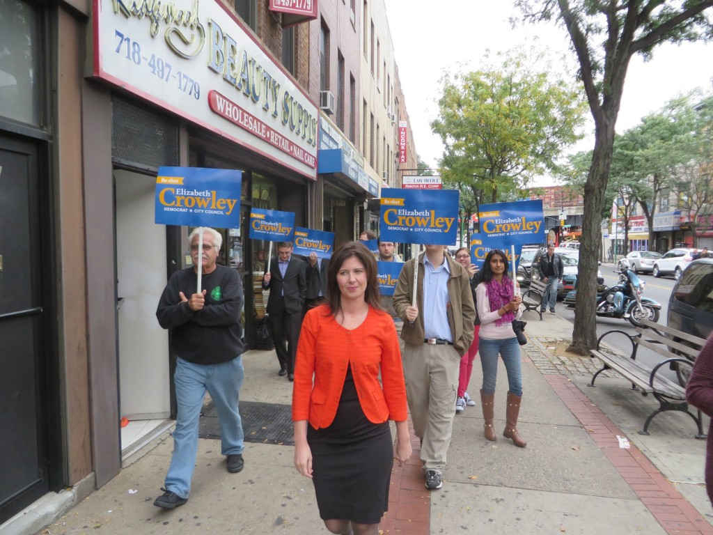 Councilwoman Elizabeth Crowley walks with supporters during a tour of small businesses along Myrtle Avenue last week. Photo Courtesy Elizabeth Crowley's Campaign