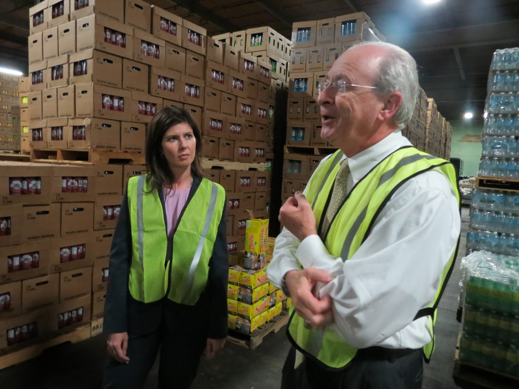 Councilwoman Elizabeth Crowley speaks with Kevin Walker, vice president of sales at the Canada Dry Bottling Company of New York, as his company's site in Maspeth last week. Anna Gustafson/The Forum Newsgroup