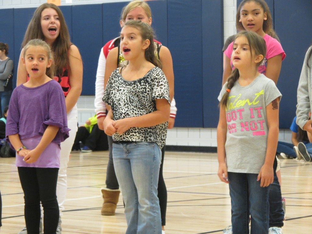The school's chorus club entertain onlookers at Tuesday's festivities.