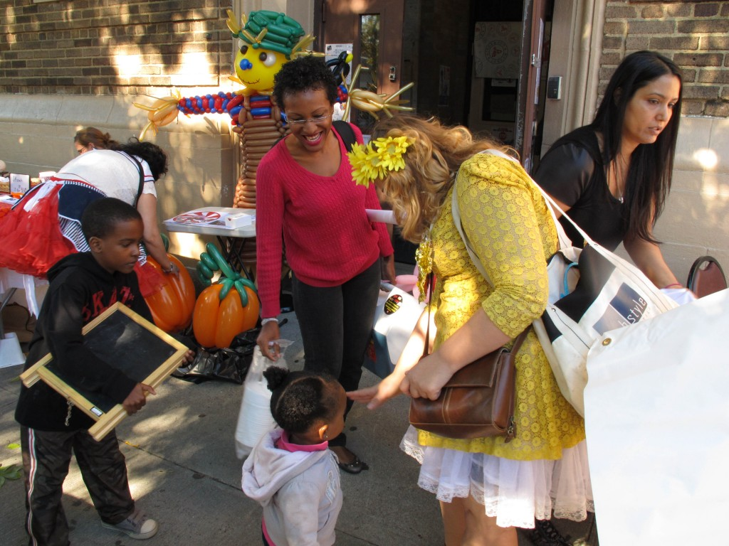 Sarah Feldman, right, spends time with some of the hundreds of area residents who have begun to flock to the Ridgewood Market. Zainab Akande/The Forum Newsgroup