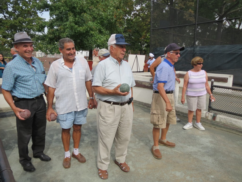 Bocce players from throughout Queens - and beyond - routinely gather at Juniper Valley Park to play the sport that has its roots in the Roman Empire. Anna Gustafson/The Forum Newsgroup