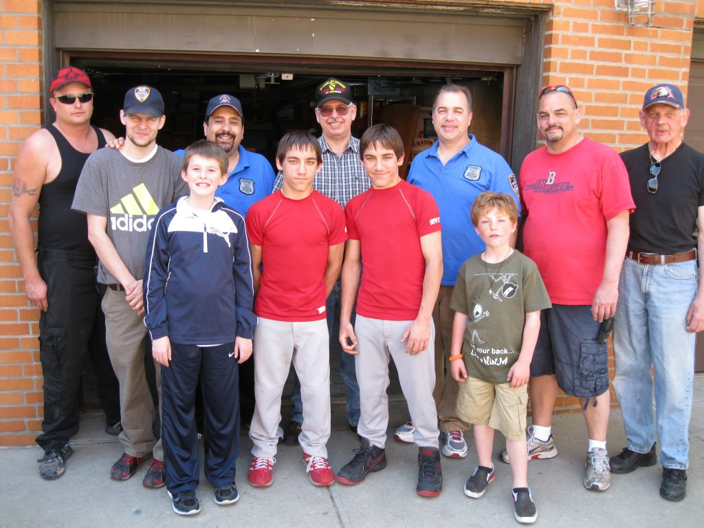 Members of the Glendale/104th Precinct Civilian Observation Patrol and some of their sons gather after making a delivery of non-perishable food to the Sacred Heart Food Pantry. Photos Courtesy Glendale/104th Precinct Civilian Observation Patrol