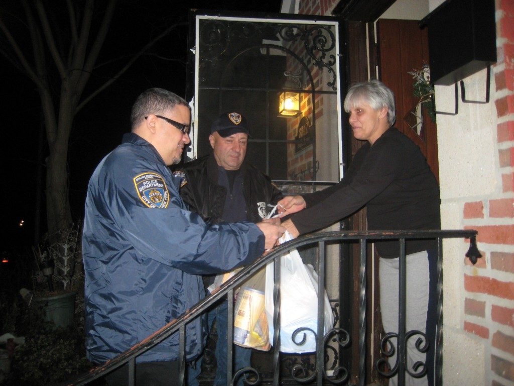 Civilian patrol members pick up donations from Glendale resident Dorie Opitz Figliola.