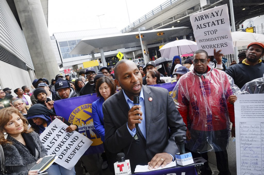 Councilman Donovan Richards, center at podium, addressed more than 100 workers who protested working conditions at JFK Airport last week. Photos Courtesy William Alatriste