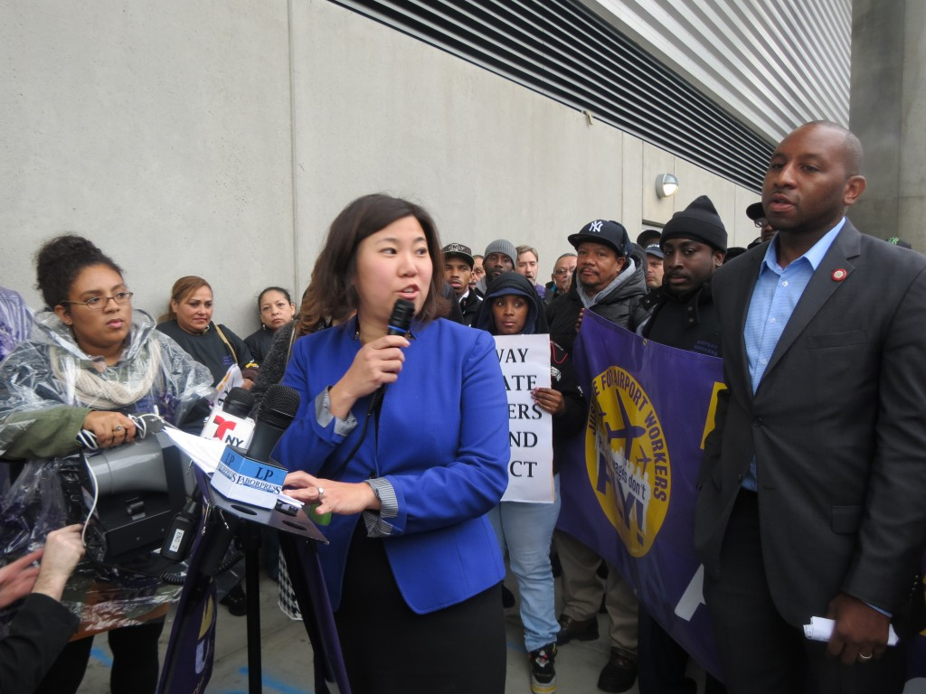 U.S. Rep. Grace Meng, center, is one of numerous legislators who is supporting workers in their fight against private contractors who are accused of doling out jobs with low wages and no benefits.