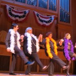 Assemblywoman Audrey Pheffer, third from left, and other performers got many a chuckle while flinging their boas around while dancing.