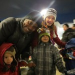 Jacob, 2, left, Erik; Justin, 5; and Tracy, of Middle Village, spend time together before Santa arrived.