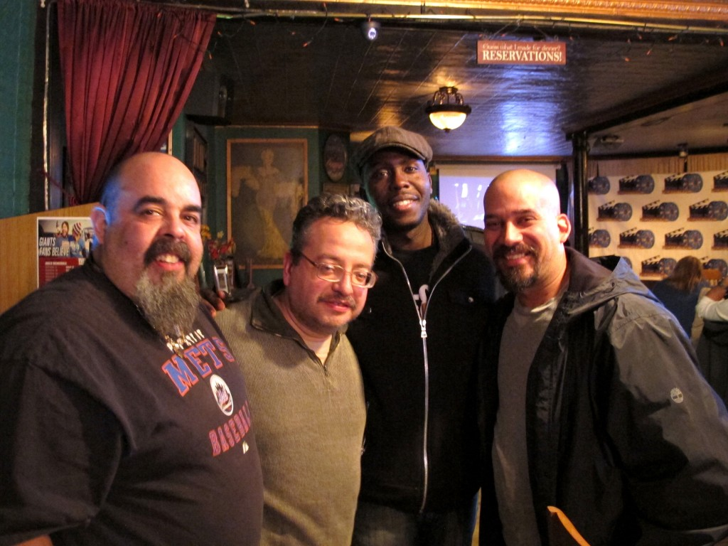 Raun Brunet, left, Mauricio Zapata , Loycent Gordon and William Ruiz gather at an evening of independent films and spoken word at Neir's Tavern in Woodhaven last week. Zainab Akande/The Forum Newsgroup