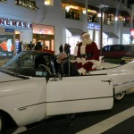 Santa arrived less traditionally, and more stylishly, in a white Cadillac this year. Photo Courtesy Atlas Park Shops