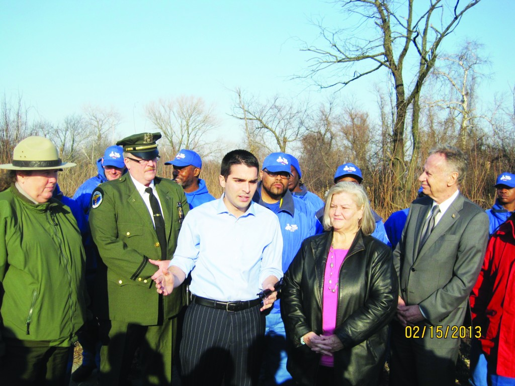 Councilman Eric Ulrich, center, works in February with the Doe Fund to help restore the stretch of roadway between Broad Channel and Howard Beach, which includes the Jamaica Bay Wildlife Refuge. File Photo