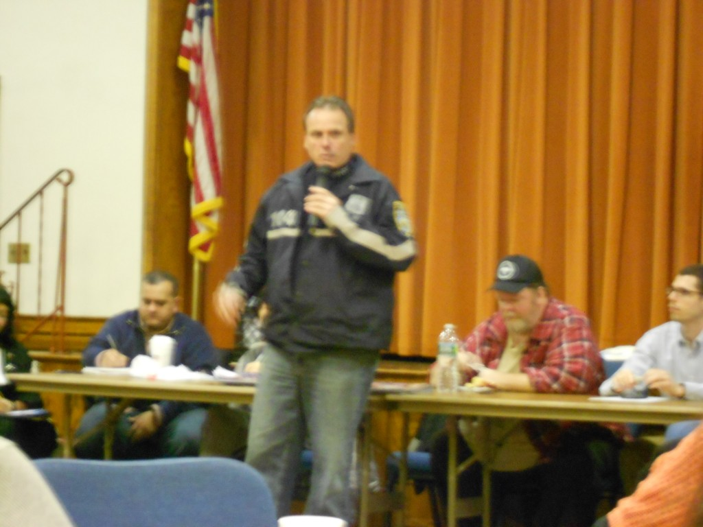G-COP President Frank Kotnik speaks about the benefits of a civilian patrol group at the Woodhaven Residents' Block Association meeting last week. Michael Florio/The Forum Newsgroup