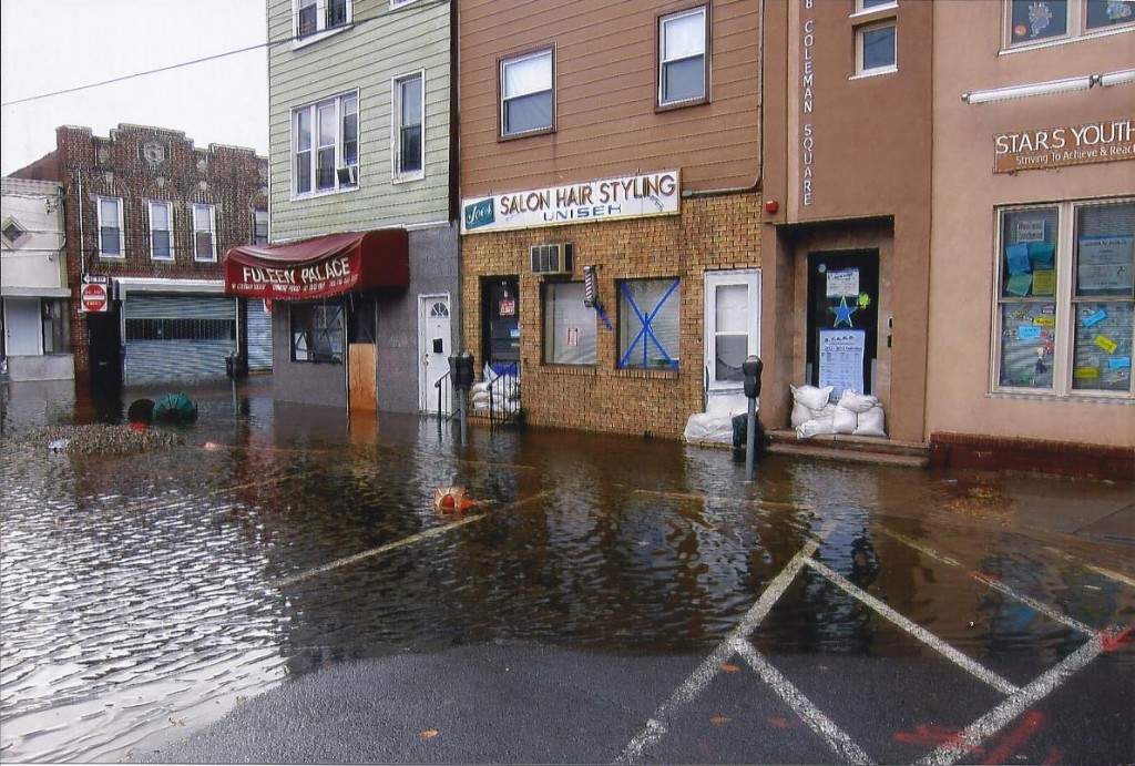 Sandbags did nothing to minimize the damage done to storefronts all along Coleman Square. The town remained essentially closed for months. Photos Courtesy OLG Church