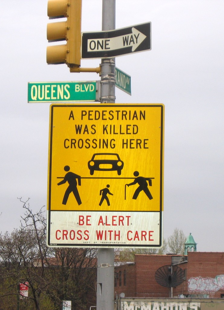 """Signs like this are posted all along the Queens Boulevard corridor which has become known throughout the world as """"The Boulevard of Death."""" File Photo"""