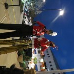 "Two ""elves"" on stilts entertained the crowd for hours."