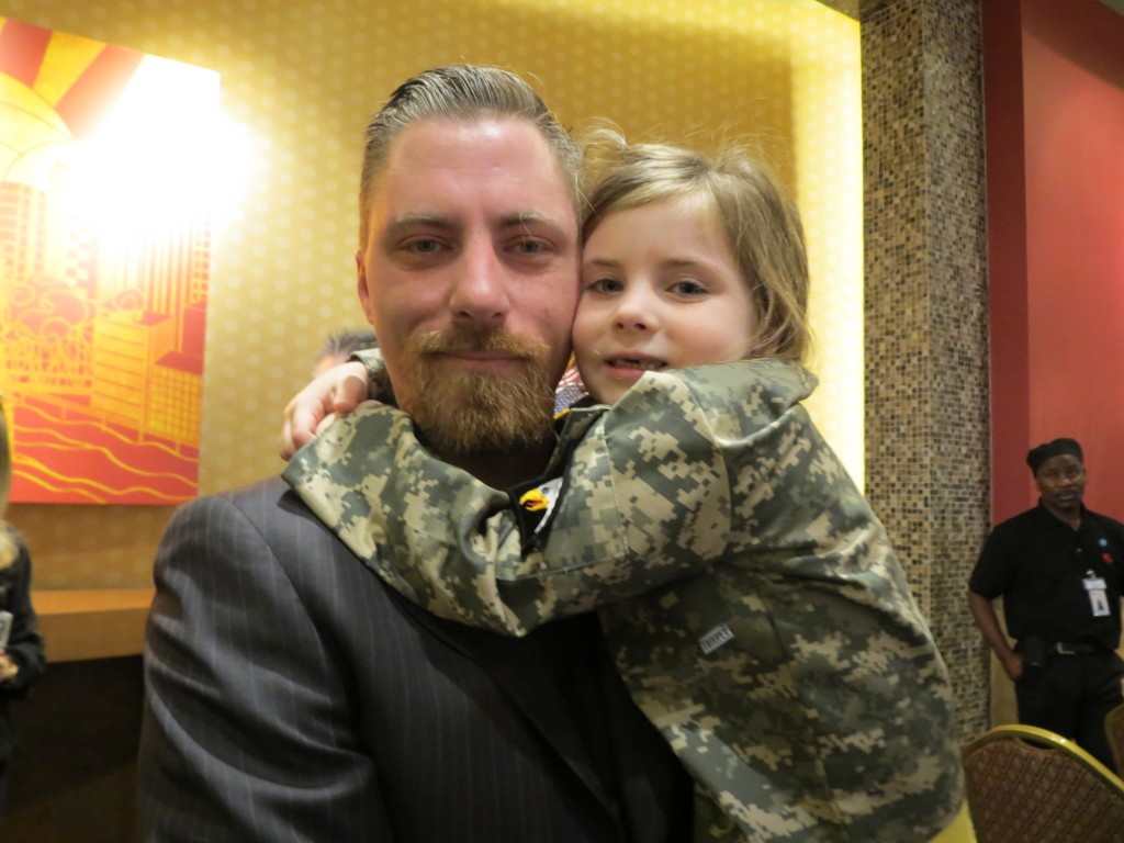 Sgt. Sean McCabe, who served in Iraq and Afghanistan, with his daughter, Kiera, 5, at a Veterans Day ceremony at Resorts World Monday. Anna Gustafson/The Forum Newsgroup