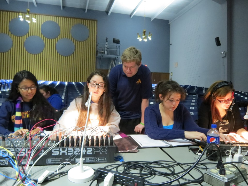 Students work on the show's lighting and sound.