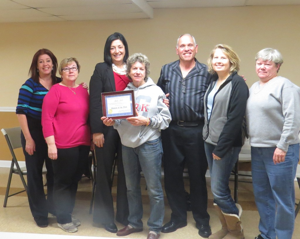 Members of the board presented an award certificate for Woman of the Year to Sheila Shale, president of the Fairfield Arms Cooperative. Pictured from l to r: Cathy, Barbara, Joann Ariola, Sheila Shale, Tony Sama, Renata. Patricia Adams/The Forum Newsgroup