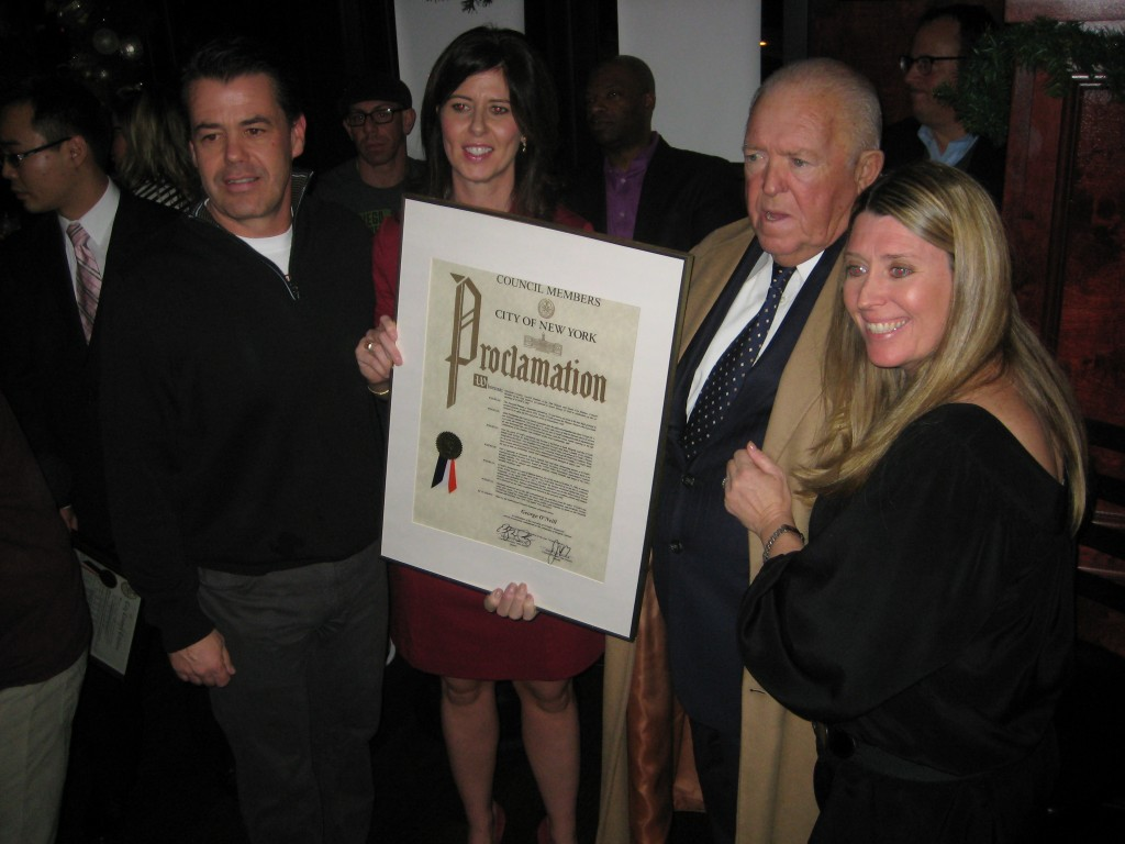 Councilwoman Elizabeth Crowley, second from left, presents a Council proclamation honoring O'Neill's 80th anniversary to the beloved restaurant's owners, Danny Pyle, left, and George O'Neill Jr., right, as Tara Pyle, O'Neill's daughter and Pyle's wife, looks on. Phil Corso/The Forum Newsgroup