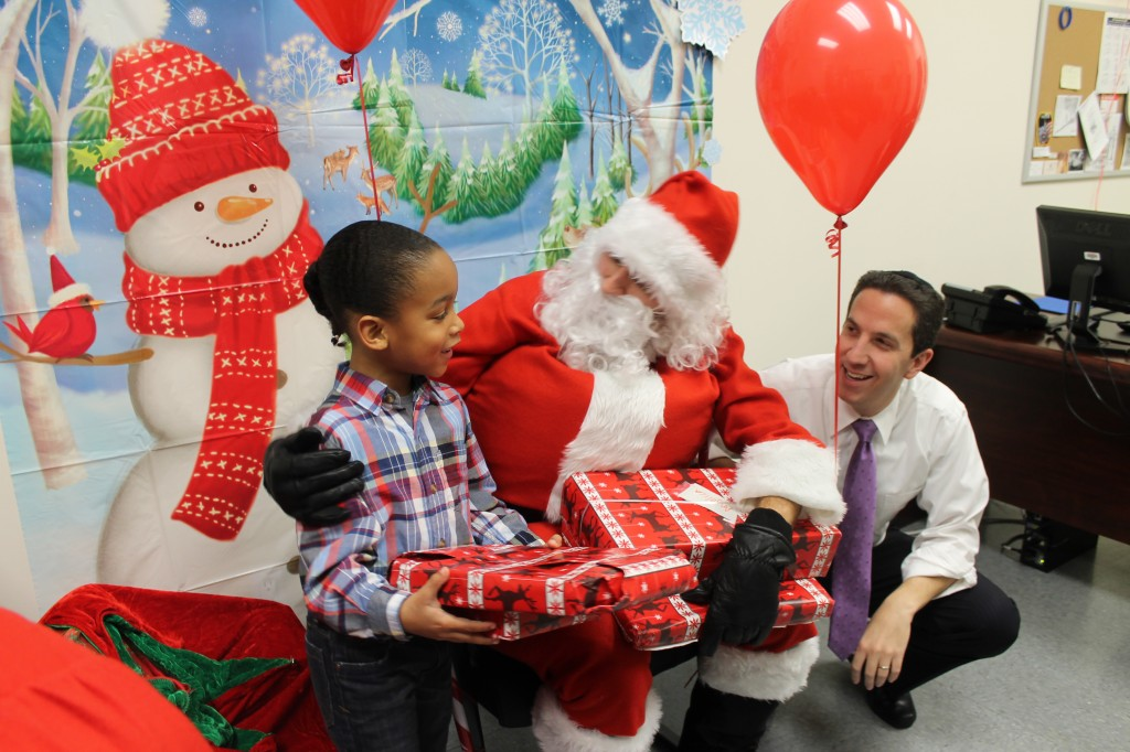 Assemblyman Phil Goldfeder, right, worked with the Secret Sandy Claus Project to turn his office into the North Pole to bring holiday cheer to children whose lives were turned upside down by Hurricane Sandy last year. Photo Courtesy NYS Assembly