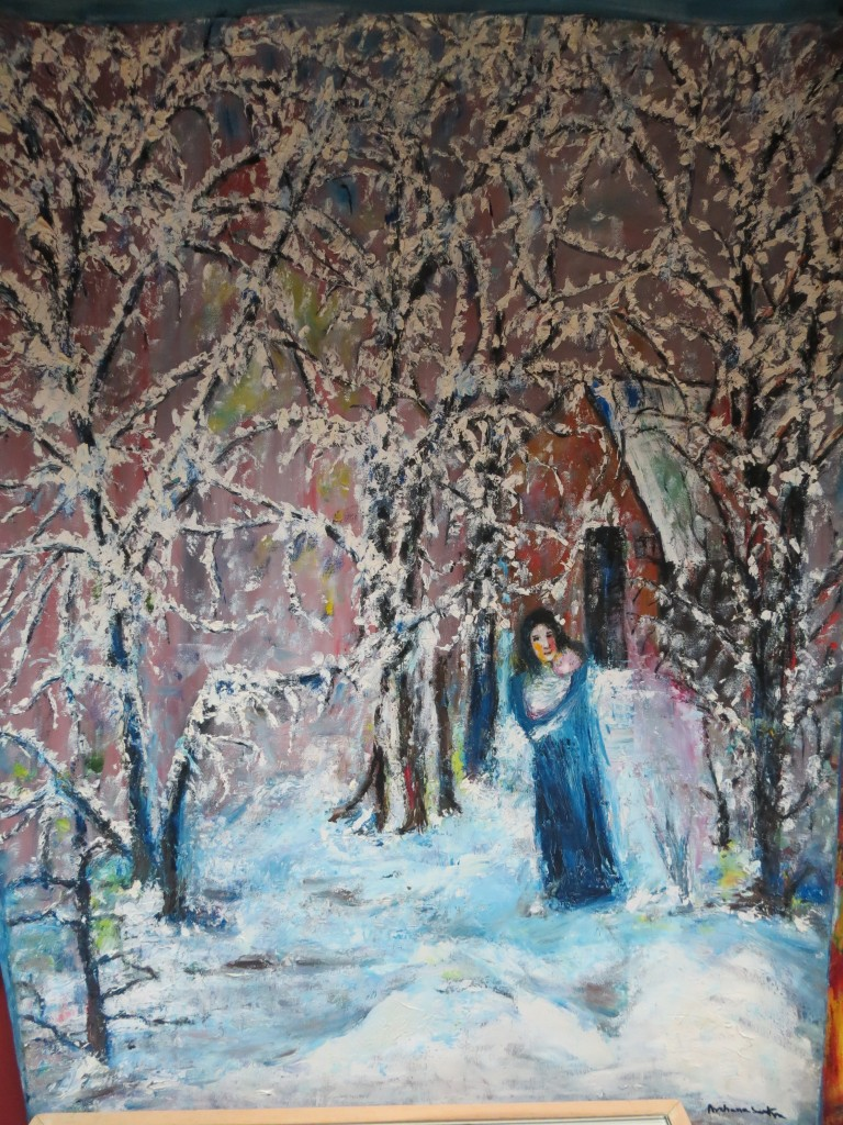 The Christmas art show includes a painting that evokes the coldness of the season - and the warmth between the bond of a mother and baby.