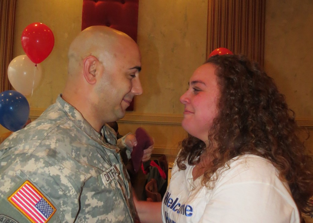 Kristian DiStefano shares a moment with his sister Arieanna DiStefano-Buonpastore. Having celebrated her 21st birthday only 2 days before on December 3, a grateful sister said there could have been no better present than to have her big brother home. Patricia Adams/The Forum Newsgroup