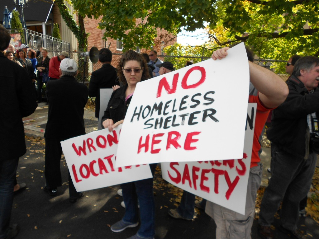 Residents have held numerous protests, including this one in November, against a proposal to operate a homeless shelter on the border of Glendale and Middle Village. File Photo
