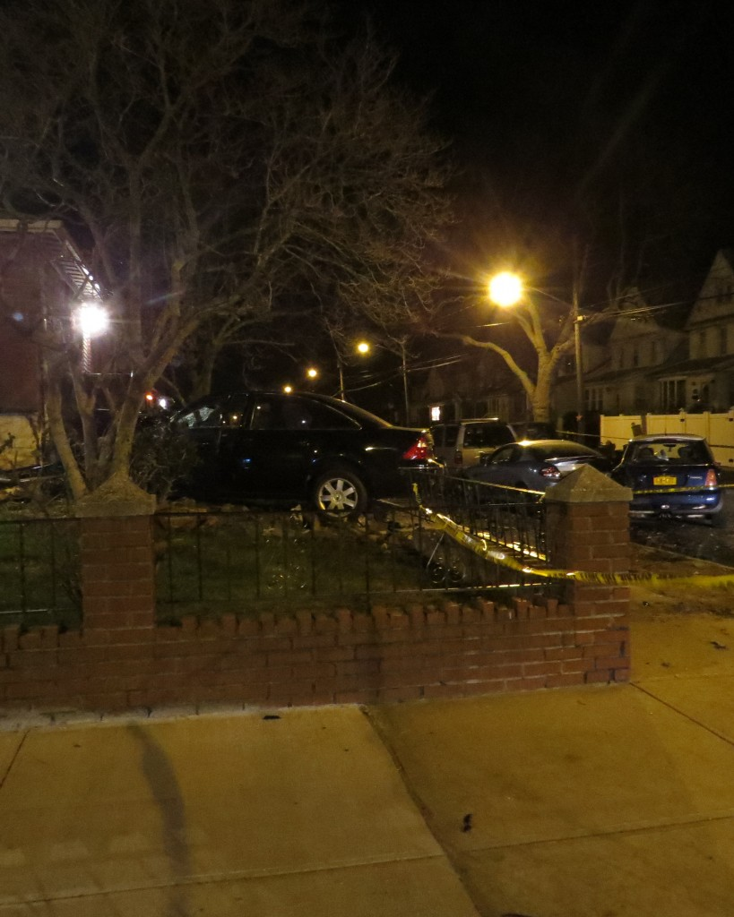 The twisted wreckage of the Ford Taurus that struck the vehicle of Jimmy Sinisi finally came to rest after plowing through a brick retaining wall and a wrought iron fence. Patricia Adams/The Forum Newsgroup