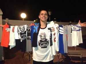 Howard Beach resident Angelo Pellegrino, who co-owns the Knicks clothing company BringIt2NY, shows off the type of merchandise he typically sells. The company, which just launched last year, announced this week that it will send Knicks gear to individuals who send in old sports gear that the company plans to donate to charity.  Photo courtesy Vincent Puleo