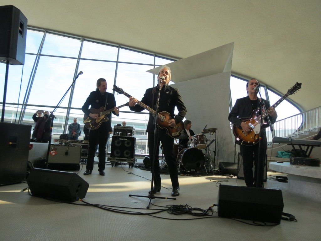 Liverpool, a Beatles tribute band, entertains the crowd gathered at JFK Airport for the 50th anniversary celebration of the Beatles' U.S. arrival. Photo by Anna Gustafson